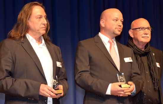 Ohley, Orgler und Brunnhofer nehmen den Deutschen Spielepreis 2014 entgegen